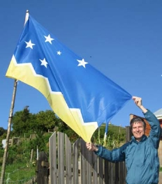 Ted Kaye with the flag of Magallanes y la Antartica Chilena (12th Region).  He found it in the village of Tenaun, which is in Los Lagos (10th Region).