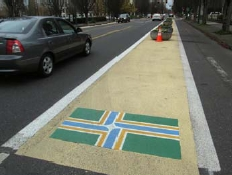 "Portland flag on the ""beeswax"" buffer between car and bike lanes on NE Multnomah St."