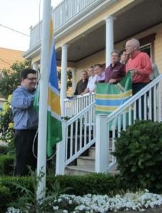 Scott Mainwaring hoists the PFA flag to start the May meeting.