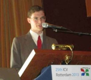 Portland Flag Association delegate Max Liberman presents a persuasive case for PFA's membership in the International Federation of Vexillological Associations (know by its French acronym, FIAV), at the 25th International Congress of Vexillology in Rotterdam.