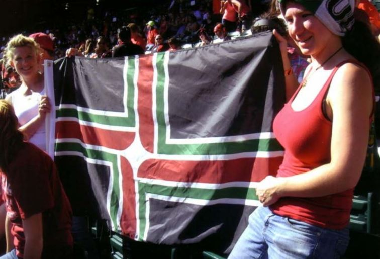 Fans of the Portland Thorns women's soccer team have created a version of the Portland flag, using the team colors of red, green, and black.  They told photographer David Ferriday that the artwork is on file at Elmer's Flag & Banner.