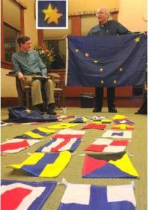 Michael Orelove displays his own astronomically-correct flag of Alaska