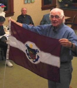 Sam Oakland shares one of his many newly-acquired flags: the Latvian Sailing Association burgee.