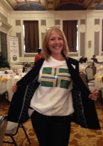 Portland City Club member and sound technician sports the flag T-shirt in the Sentinel Hotel ballroom.