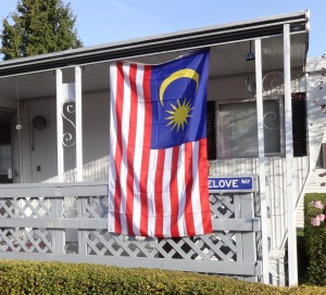 Michael Orelove is commemorating the MH370 disaster by flying the Malaysian flag.