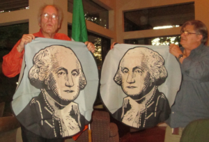 By deconstructing an actual flag, Michael Orelove (L) demonstrates that                                      Washington's obverse is actually the mirror image of its reverse (so George always faces the hoist).