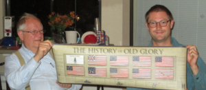 David Ferriday (L) and Carl Larson (R) with historic US flags poster.