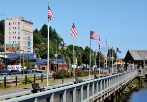 US flags fly along the Coos Bay Boardwalk.  Photo by Lou Sennick, The World.