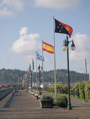 International flags fly along the Coos Bay Boardwalk.  Photo from Oregon Coast magazine.