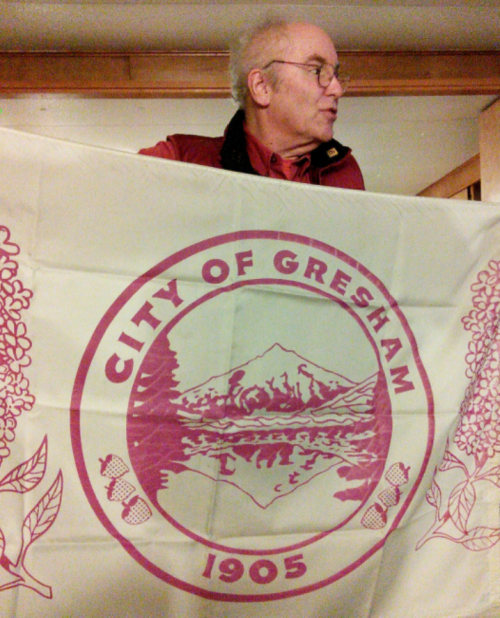 In honor of our meeting in Gresham, Michael Orelove unfurls its flag.