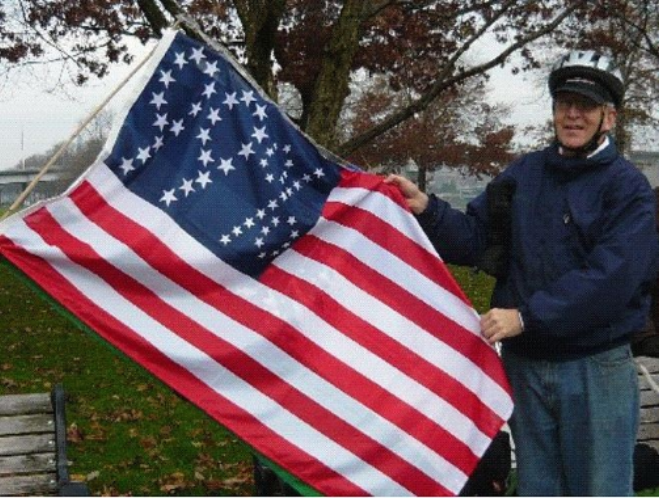 99% US flag, designed and manufactured by Peter Orenski's TME Co.  Ted Kaye delivered this one to the Occupy Portland    protesters in early December 2011 at Salmon Street Springs.  Photo by Ted Kaye.