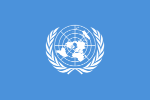 The UN flag.  Adopted 1946, emblem designed by Donal McLaughlin.