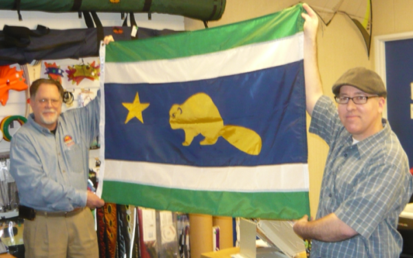 "Mike Hale presents designer Randall Gray with his ""new"" Oregon Flag"