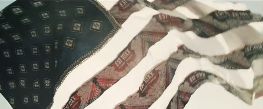 US flag made from printed fabric.  Image from official video.