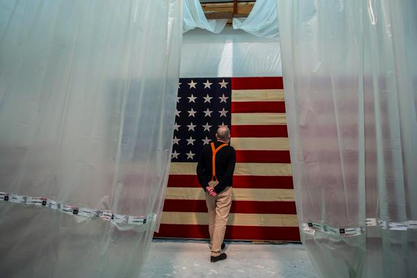 AA Bronson examines one of his flag-canvasses in process of producing the White Flag exhibit at Galerie Esther Schipper, Berlin. From his twitter feed.