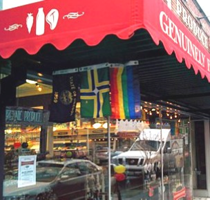 To garner favor after an anti-gay controversy, the Moreland Farmer's Pantry flies Oregon, Portland, and Rainbow flags.  (Thanks to Bill Trinkle for the tip.)