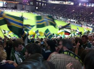 Portland flags waving at a Timbers game in 2011.  Photo by Kristin Wolff, via Foursquare.