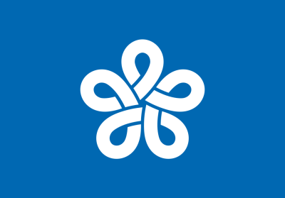 All of Japan's prefectures use what are essentially logos for their flags (and as a result can be mistaken for corporate flags).  This is Fukuoka's, a stylized  ふく (fuku) that also symbolizes a plum flower.