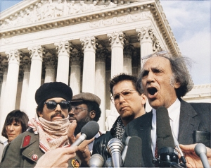 Gregory Lee Johnson (2nd from right) and his lawyer William Kunstler (on right) before the Supreme Court.