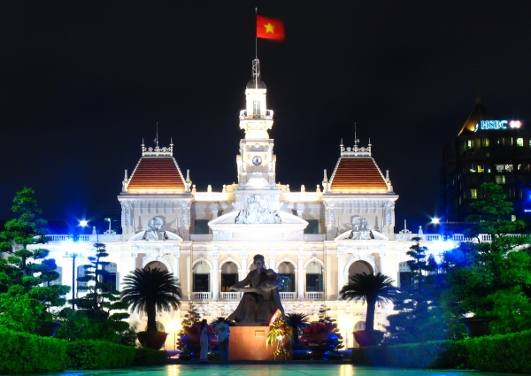 The flag of unified Vietnam flies above Ho Chi Minh City People's Committee (formerly Saigon City Hall).  Photo by Joshua Rappeneker, 18 Sep 2006.