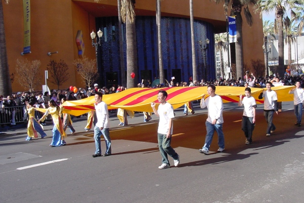 Members of the Vietnamese Student Association at San Jose State University march with the Heritage Flag.  Photo on flickr by Bao Thien Ngo, 29 January 2006.