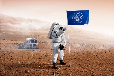 A Mars explorer drives out into a shallow valley, inexplicably, to plant a plastic looking banner/flag.