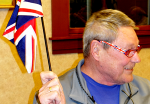 Larry Snyder shows off his Union Jack reading glasses.