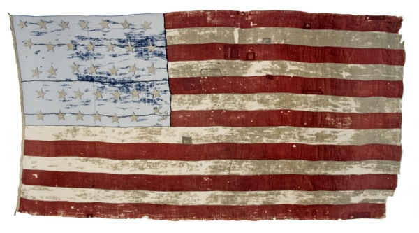 "This is ""Old Glory"", the 23-star-plus-one-anchor, 10' x 17' flag given by the people of Salem, Massachusetts to Captain William Driver prior to his around-the-world trip commanding the brig Charles Doggett in 1831.  He exclaimed ""I'll call her Old Glory, boys, Old Glory!"".  Years later, in 1862, after keeping the flag safe in Nashville during the Civil War, Driver was given permission to raise his flag over the Tennessee state capitol, making Old Glory famous as the first US flag to fly over a former Confederate capitol.  (By 1862 the US flag had grown to 34 stars, but Driver was persuasive!)"