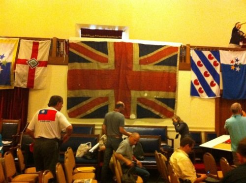 One of the many highlights of the ZFC, a British Union Jack from the Battle of Trafalgar, the only one known to survive.  (Smaller flags to the side represent vexillological associations represented at the congress.) Photo by Scott Mainwaring.