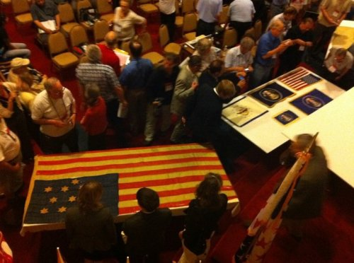 ICV 25 attendees admire flags from the ZFC.  Photo by Scott Mainwaring.