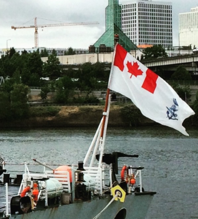 The Canadian Naval Ensign flies from the frigate HMCS Calgary (FFH 335).