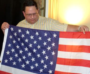 "Scott Mainwaring and his U.S. flag with ""randomly perturbed"" stars."
