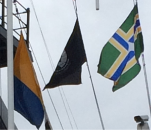 "The maritime signal flag ""K"", the POW-MIA flag, and the Portland city flag fly on the USCGC Waesche."