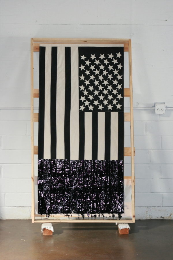"Black and White Tar flag, 2013. 33""/66"" canvas, acrylic paint, tar."