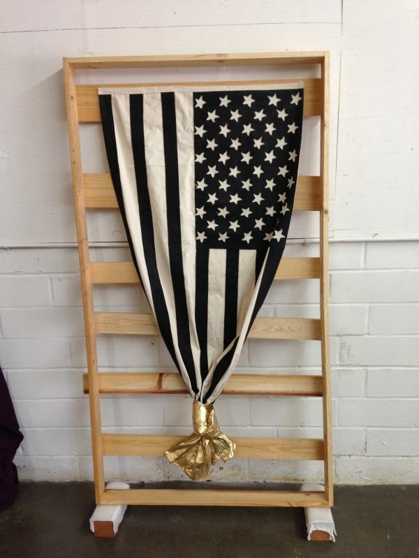 "Flag (Golden Knot), 2013. 64""/31.5"" acrylic paint, oil paint, polyester resin, canvas."