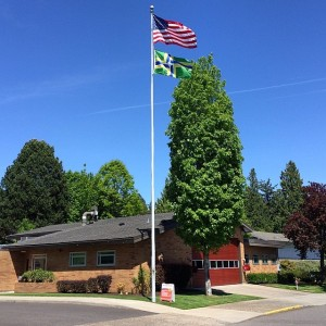 The US and Portland flags fly above Portland Fire & Rescue Station 5.  Photo by Scott Mainwaring.