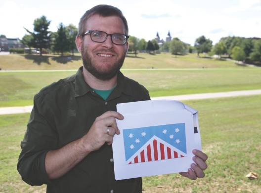 ÒItÕs a lot of symbolism that I think is more modern and relevant than whatÕs there now,Ó said Mark van Der Hyde of Dracut, showing his proposed design for a new city flag at LowellÕs South Common. SUN / JULIA MALAKIE