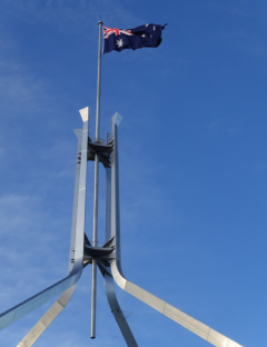 The 21'x42' national flag flies on a 266' pole above Parliament in Canberra.