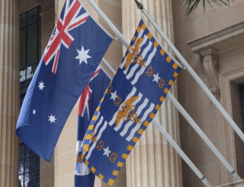 The flags of Australia, Queensland, and Brisbane adorn the city hall there.