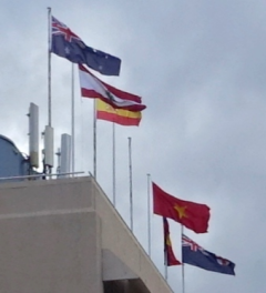 Flags adorn a Sydney hotel—although the Vietnamese flag is upside-down.