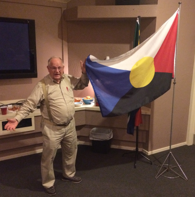 David Ferriday with his Flag for All Mankind in the 21st Century.