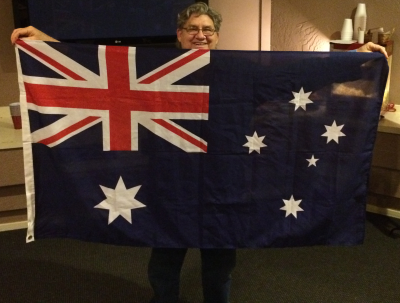 Patrick Genna with a flag fairly often found at Goodwill -- New Zealand, Australia, or something.