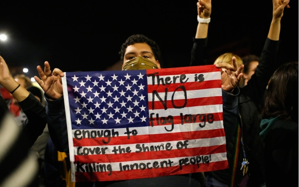 From a 7 December 2014 protest in Berkeley, California, against a New York grand jury's decision not to indict police officer involved in the killing of Eric Garner. Photo by Stephen Lam, Reuters.
