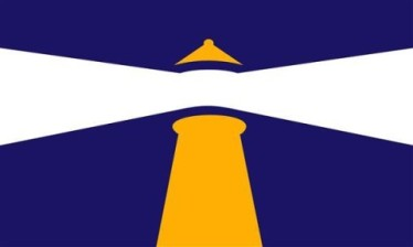 """Portland Beacon"" by Matthew Morey Designer's comments: The purpose behind this design for the flag of Portland is to display a beacon of pride in being a Portlander and a beacon of welcome to all others, just as the lighthouses of Portland welcome ships into its harbor. The lighthouse also represents Portland's rich history in the maritime industries which helped Portland become the diverse, ever-growing city it is today. The goal was to accomplish all this with simple and dynamic use of shapes and a reference to the original blue and gold color scheme of the current flag. Judge Ted Kaye's comments: An outstanding rendition of a lighthouse—not a particular site but an allegory for Portland as a beacon—makes for a stunning design."