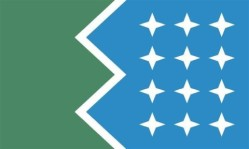 """""""Jewel of Casco Bay"""" by Jeff Woodbury Designer's comments: Green for Forest City. Blue for Casco Bay. The zigzag echoes waves on a rocky coast. Portland is the central point: the peninsula in the center, pointing to the stars. Indents above and below center represent the Fore and Presumpscot Rivers. 12 stars shine for the 12 major islands of Casco Bay. Each 4-pointed star is a compass rose, symbolizing both direction and the individuality of Mainers. The stars in a grid combine to weave the warp and weft of lobster traps and sailcloth. Turned on its end, green side down, the constellations illuminate forested mountains. Green side up, and ships rest safely at anchor. Uncomplicated, but not simplistic. A flag for Portland. Judge Ted Kaye's comments: It's refreshing to see the division of a flag's field hold meaning—in this case the serrated line representing the division of coast and sea. The four-pointed stars for islands create an effective pattern."""