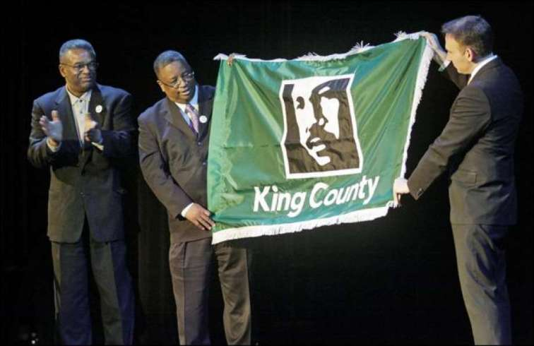 ty_Councilman_Larry_Gossett__and_King_County_Chair__Dow_Constantine_Unveil_the_New_County_Flag__January_2009__Seattle_Times__1